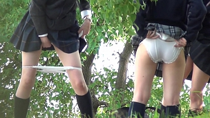 Kinky Co-Eds Peeing In Public - Scene 1
